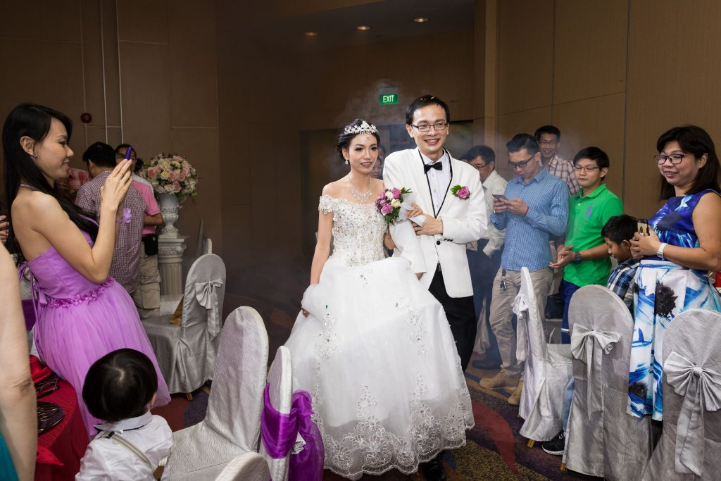 A couple marching into the ballroom at SAFRA Mount Faber.