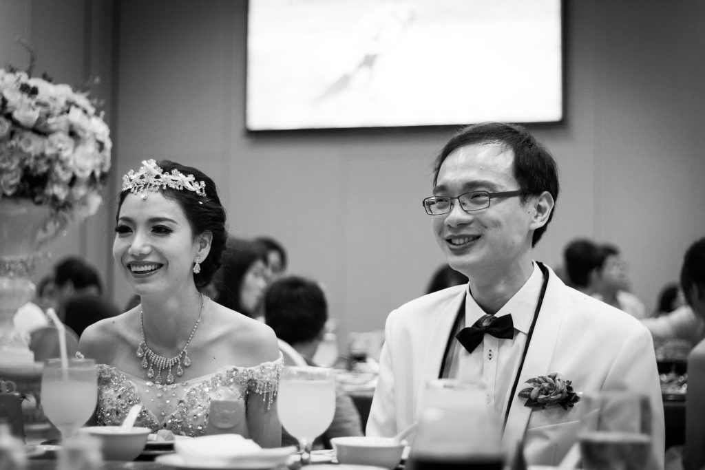 A candid photo of the couple smiling.