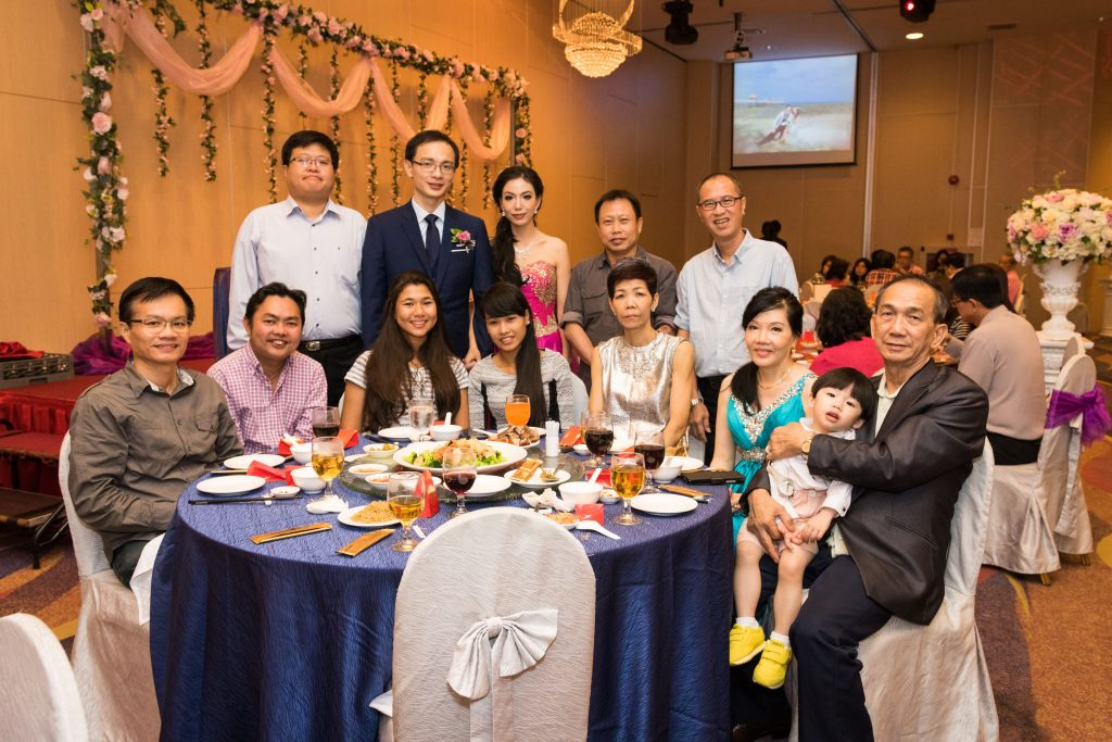A group photo at a Singapore Chinese wedding dinner.
