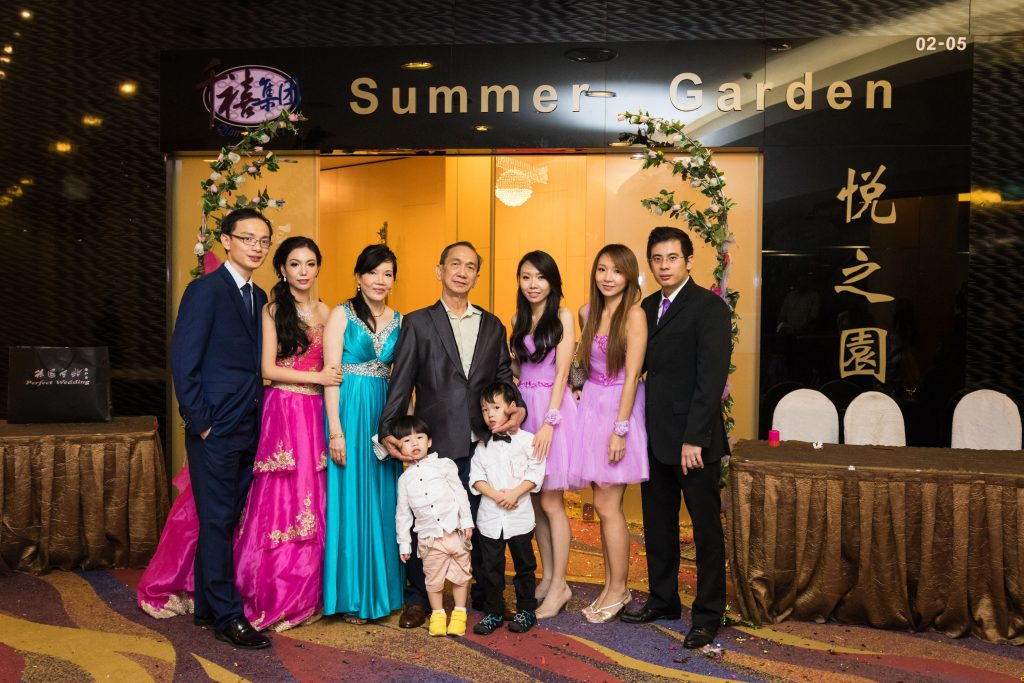 A family photo at a Chinese wedding dinner.