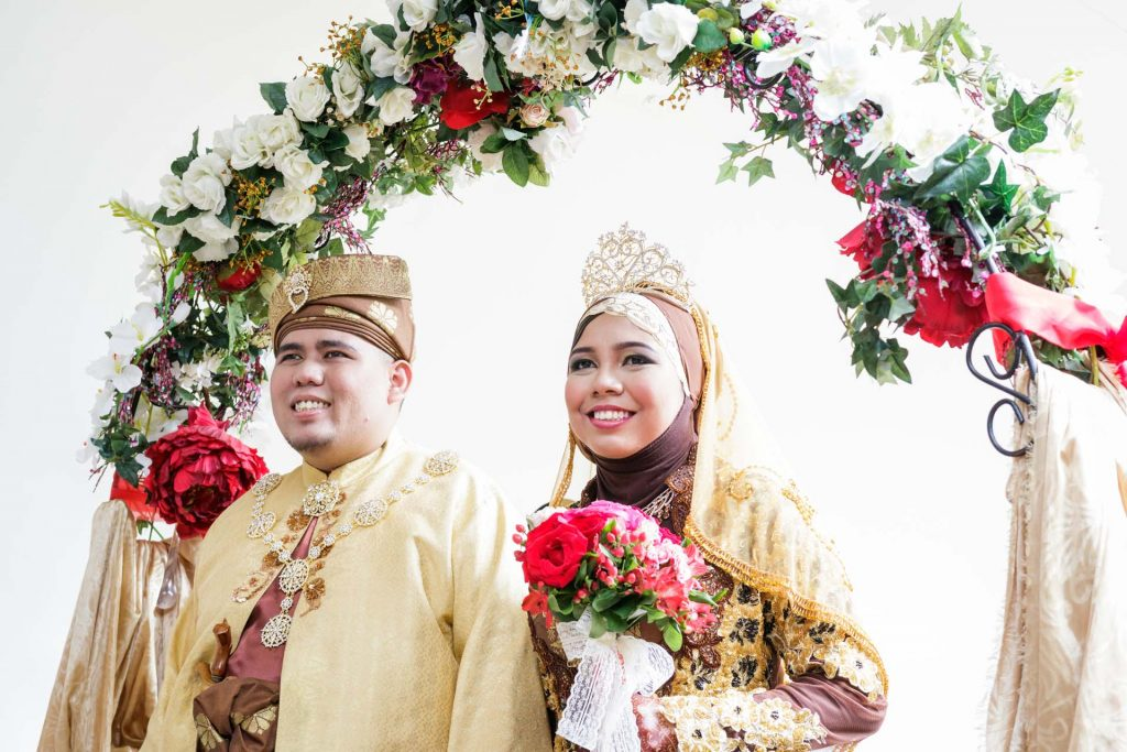 The bride and groom at a Singapore Malay wedding.