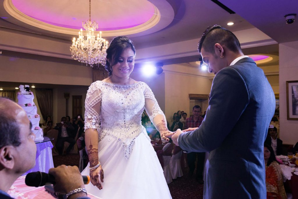 Exchanging the rings at a solemnization, photo by Singapore wedding photographer Shilton Tan.