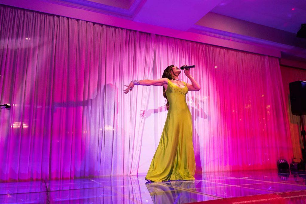 Drag Queen El Nina performing at a wedding, photo by Singapore wedding photographer Shilton Tan.