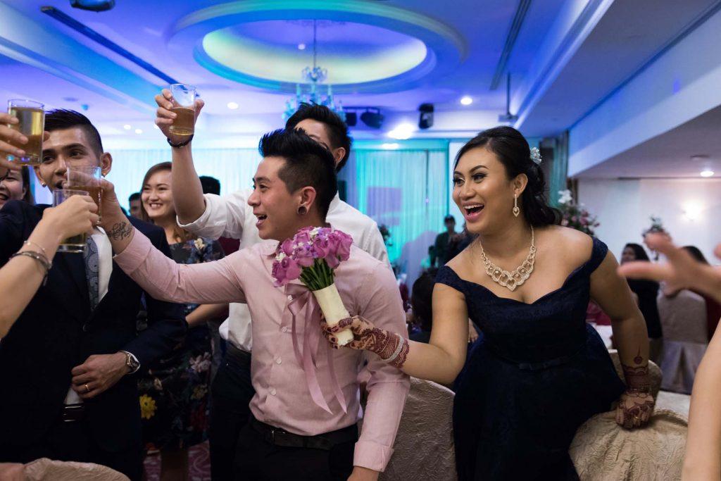 A toast to the couple, photo by Singapore wedding photographer Shilton Tan.