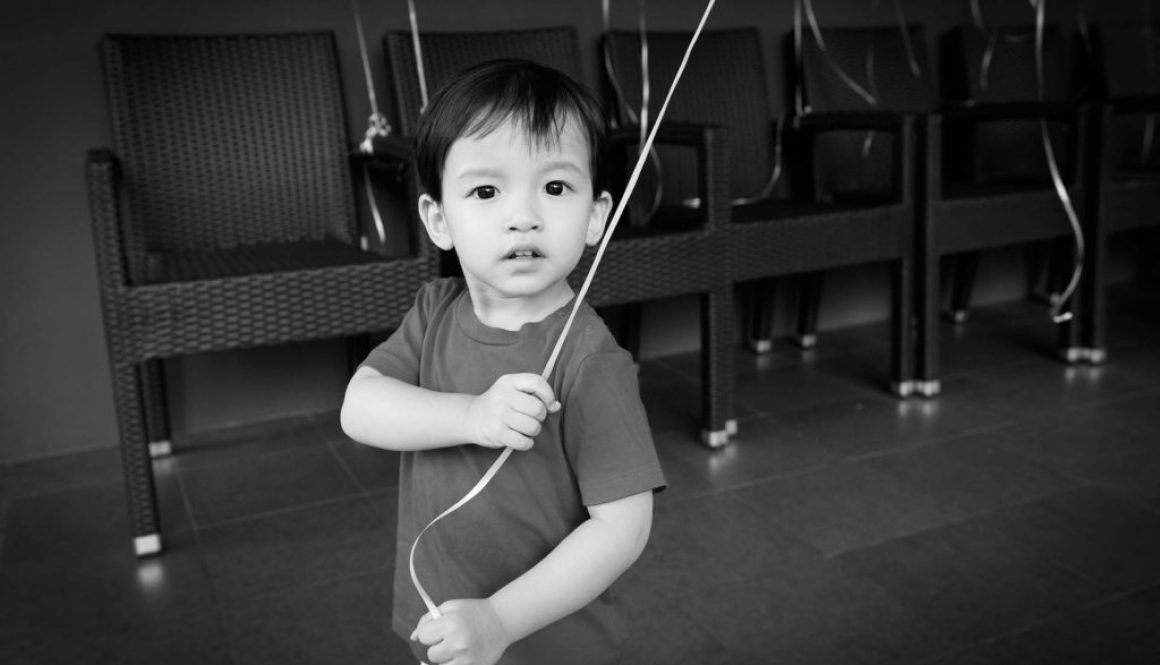 A photo of the birthday boy, birthday party photography by Singapore photographer Shilton Tan.