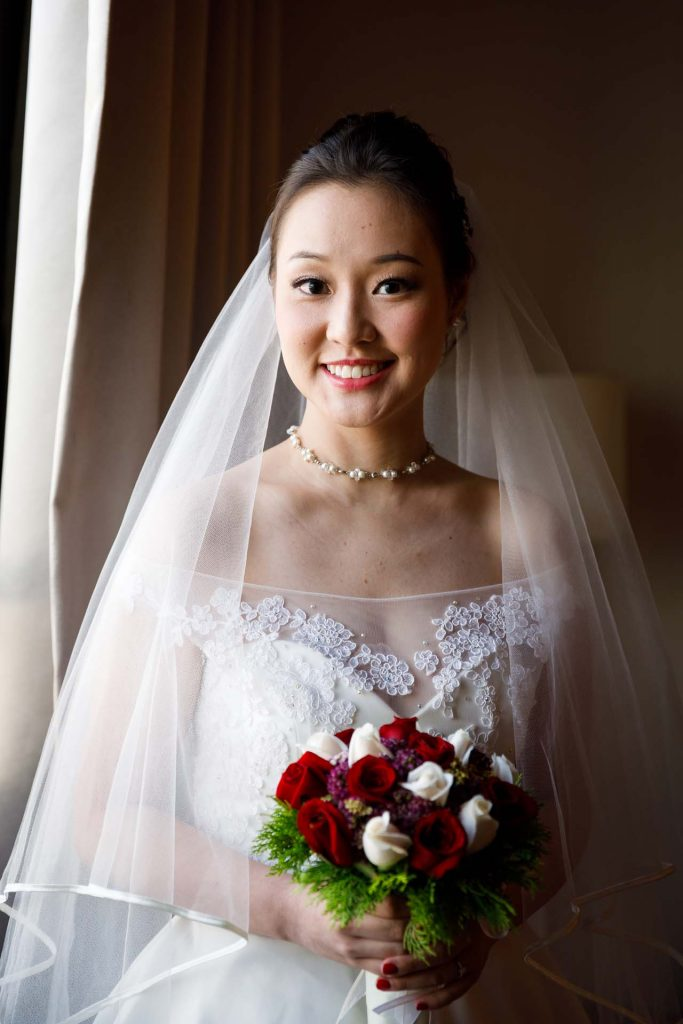 A portrait of the bride at Rendezvous Hotel Singapore.