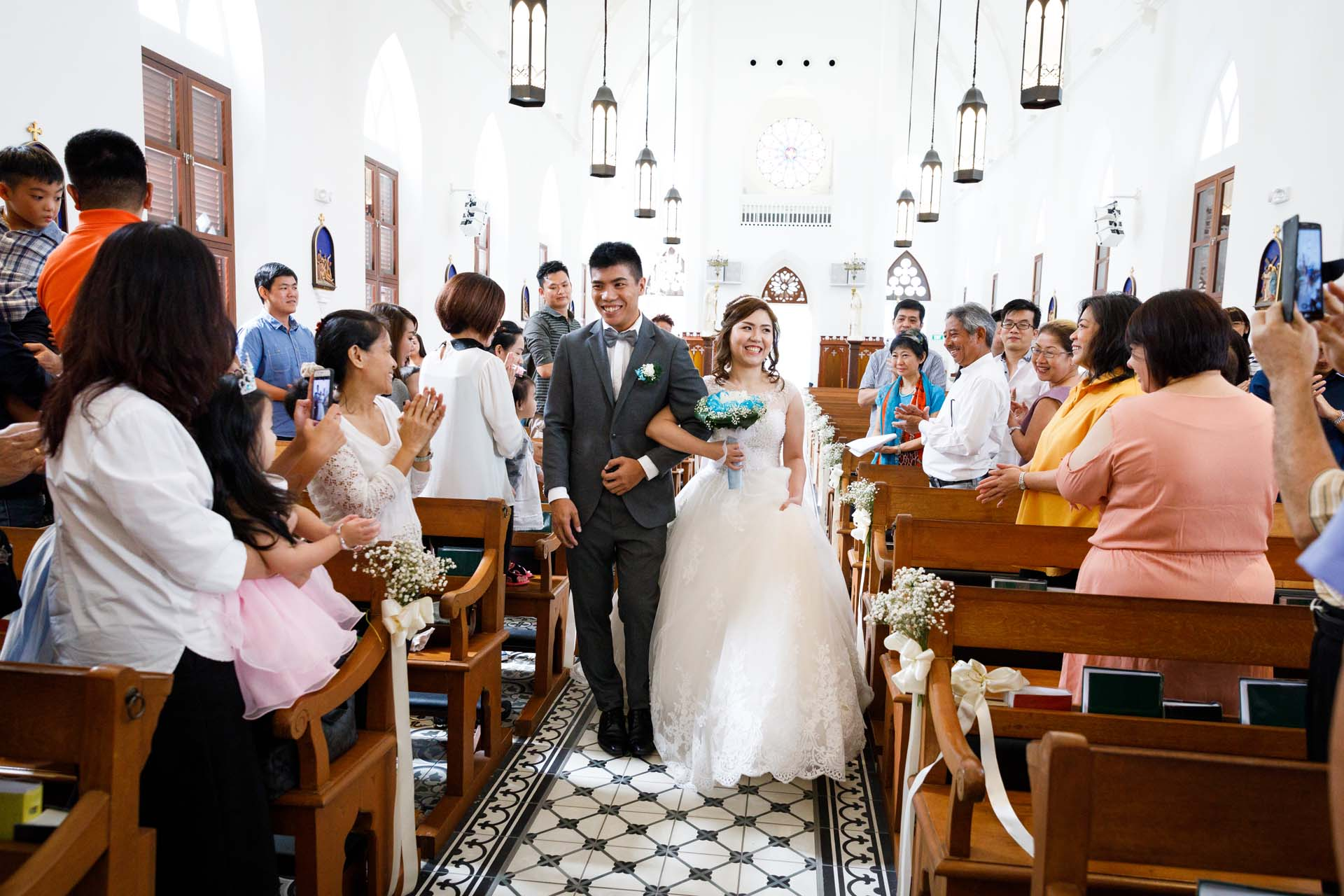 The couple entering the church.
